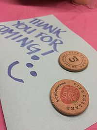 Caption: Vancouver Farmer's Market tokens, an incentive to enter the survey